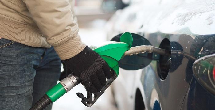 filling car gas tank winter
