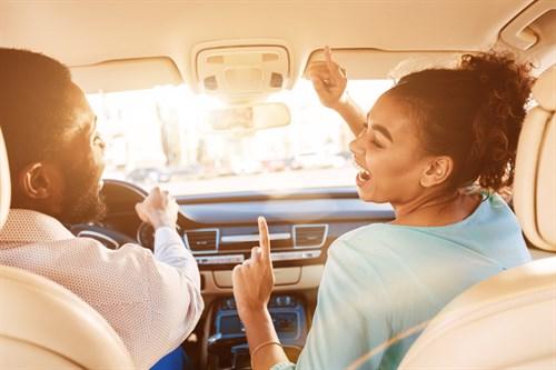 Enjoy Journey Couple Listening Music In Car L69UQP3