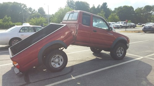 Truck Bent Half Rusty Frame