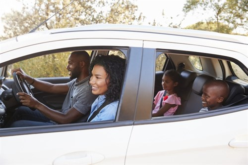 Young Family In Car With Grinding Brakes