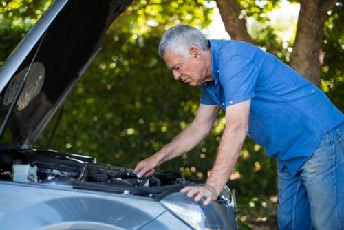 Man Checking Loud Car Engine