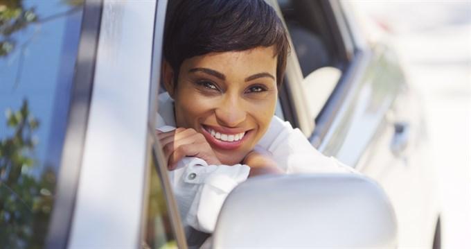 Woman Driving Shiny Car